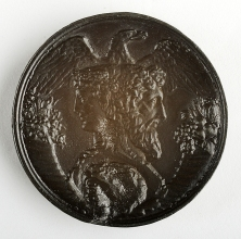 Medal depicting two-faced head