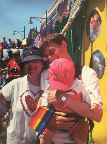 Forum - Laminated photograph - two women with child at Pride (2011-6)