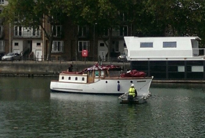 Ngaire's boat being towed in for some maintenance